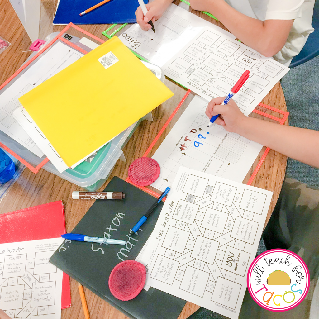 Students completing math maze worksheet during math stations